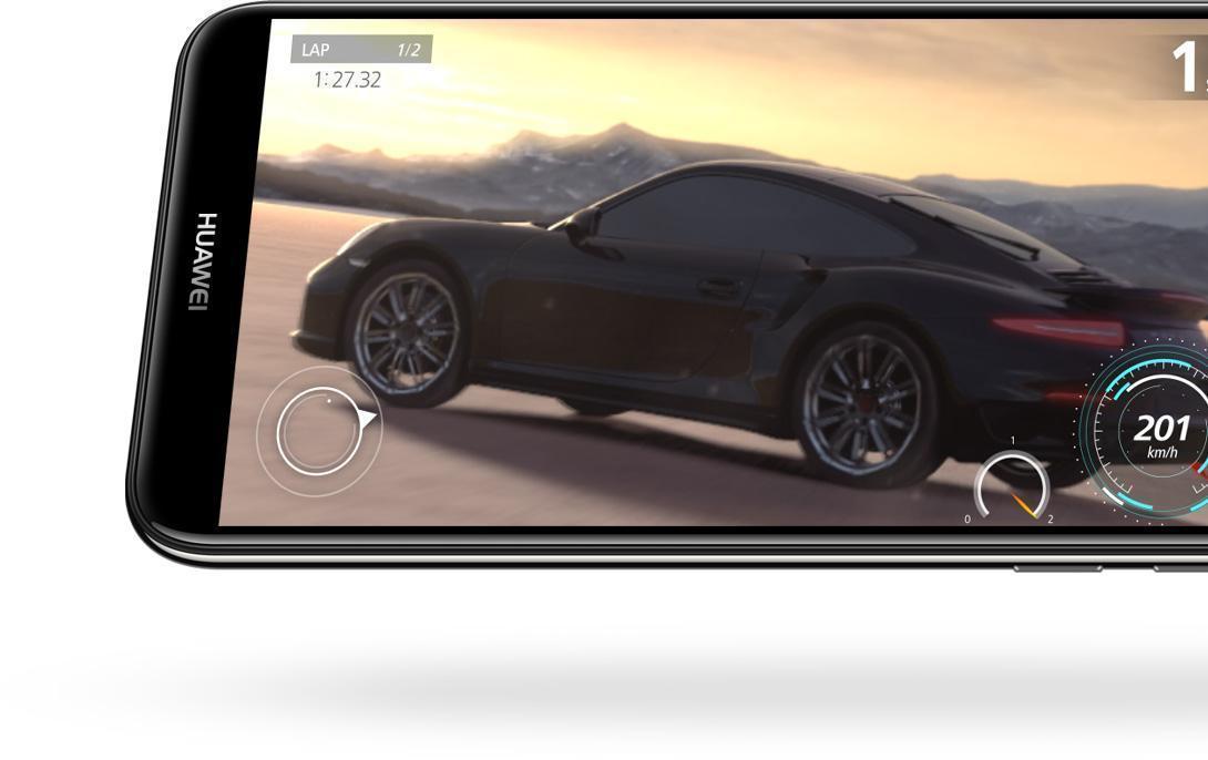 هاتف huawei y7 prime 2018 بالعرض باللون الأسود مع لعبة عربات تسابق